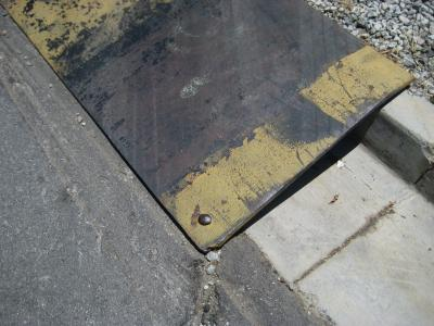 Railroad Spike Keep Curb Rampt in Place